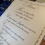 Détail du menu imprimé sur papier ivoire nacré